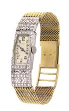 An 18k two-color gold lady wrist watch ZENIT with old cut diamonds