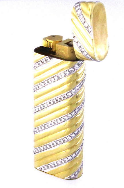 An 18k yellow gold CARTIER Paris lighter ref.73073 with diamonds