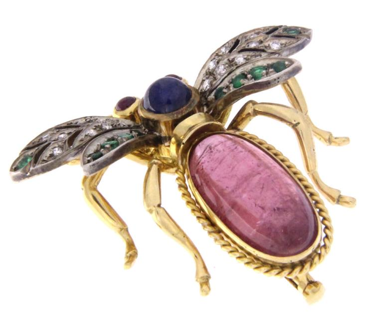 An 18k yellow gold bee brooch with a drop cabochon pink tormaline, sapphire, rubies, emeralds and diamonds