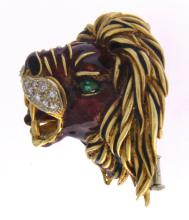 An 18k gold FRASCAROLO lion head brooch with enamel, emeralds and diamonds.