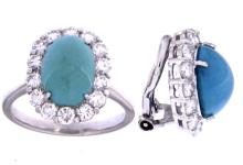 An 18k white gold pair of earclips and ring set with oval cabochon turquoise and diamonds