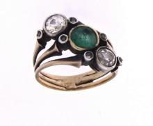 An antique 18k gold three stones ring with emerald and diamonds