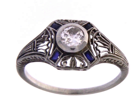 An 18k white gold art Deco' filigree ring with an old cut diamond