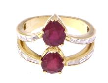 An 18k yellow gold ring with rubies and diamonds
