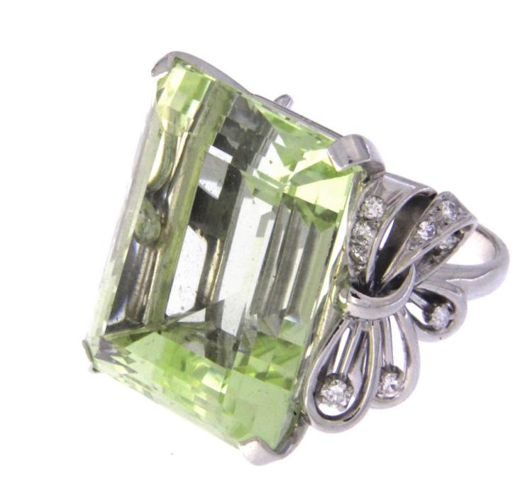 An 18k white gold cocktail ring with a bright  green beryl and diamonds