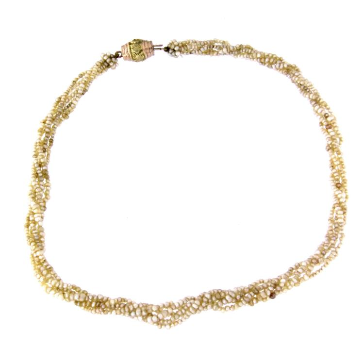 Five strand of seed pearl with an 14k gold clasp.