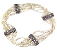Nine strand of seed pearl choker with 18k two-color gold clasp, elements and diamonds