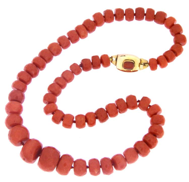 A red coral faceted bead necklace with 14k yellow gold clasp