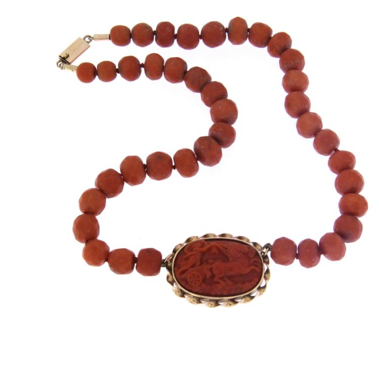 An antique red coral necklace with a carved red coral cameo and k14 yellow gold clasp