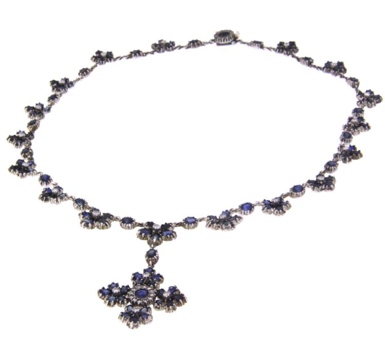 An antique palladium necklace with sapphire and diamonds