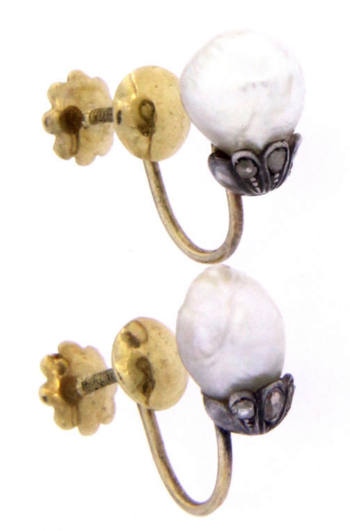 An antique 18k gold pair of earring with baroque natural pearls and rose cut diamonds