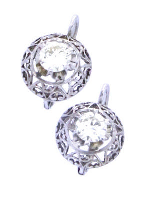 An 18k white gold pair of earring with two brilliant cut diamonds