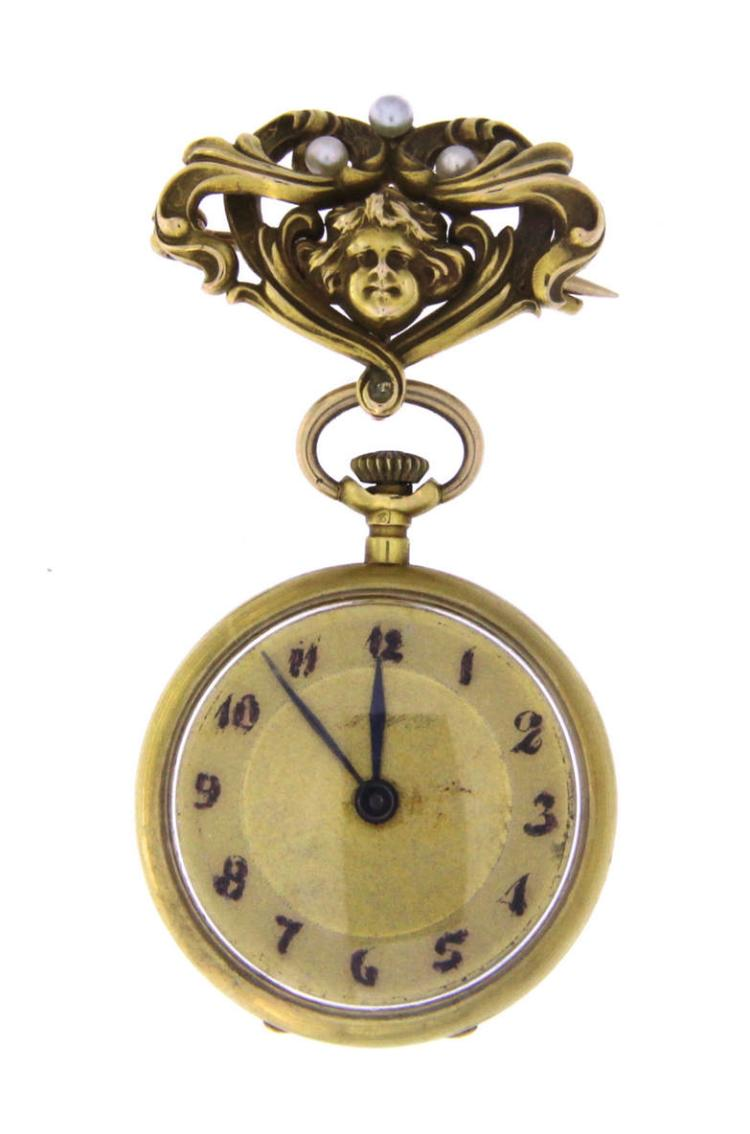 An 18k yellow gold art Nouveau lapel watch with seed pearls.