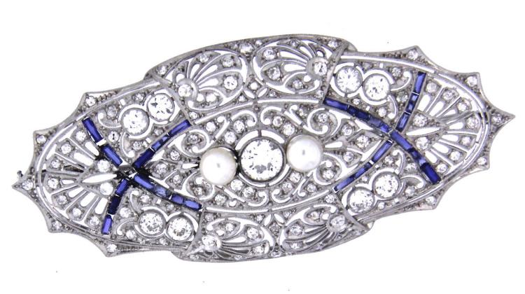 An 18k white gold art Deco filigree brooch with diamonds, pearls and sapphires.