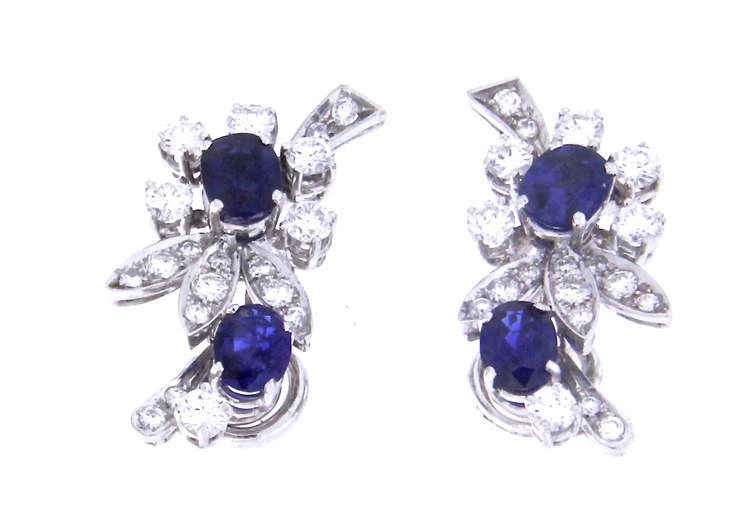 An 18k white gold earclips with vivid blue sapphire and diamonds
