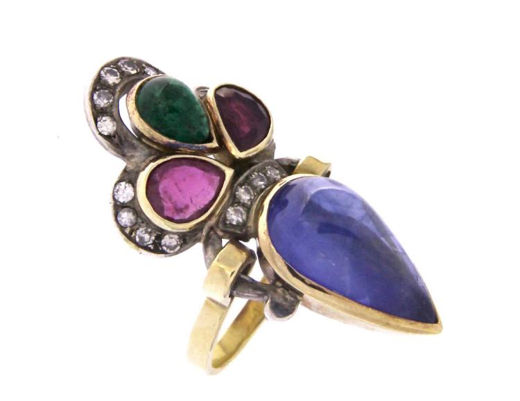 An antique18k gold ring with sapphire, rubies, emerald and diamonds.
