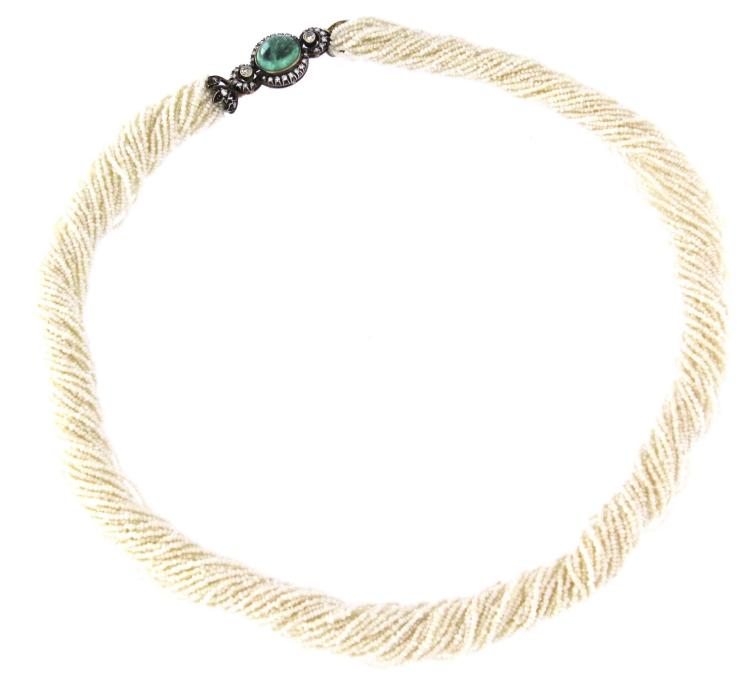 A seed pearl multi strand necklace with 18k gold clasp with emerald and diamonds.