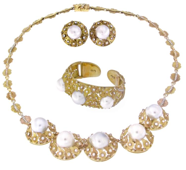 An 18k yellow gold engraved necklace, bracelet and ear clips set with South Sea pearls and diamonds