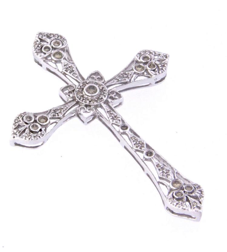 An 18k white gold filigree cross with diamonds