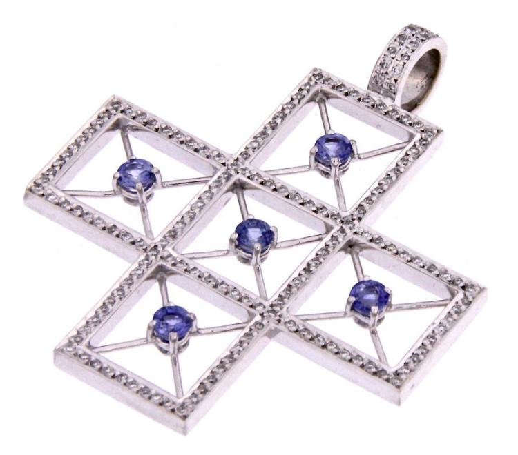 An 18k white gold cross with sapphire and diamonds