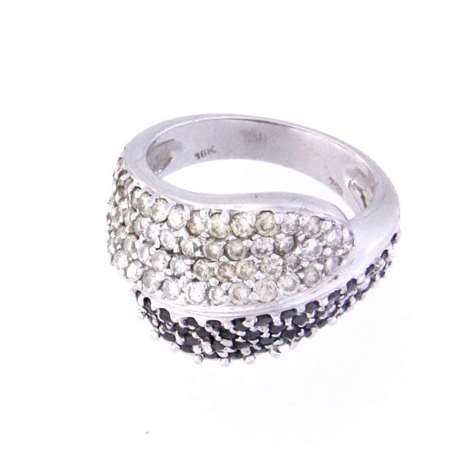 An 18k white gold contrarie' ring with white and black diamonds