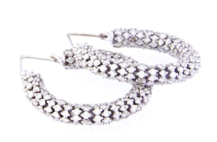 An 18k white gold pair hoop earring with diamonds