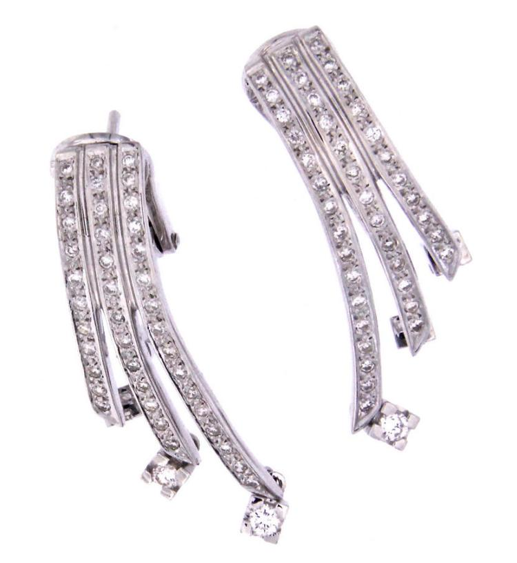 An 18k white gold pair of earclips with diamonds