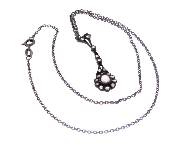 A black rhodium plated silver chain with rose cut diamonds