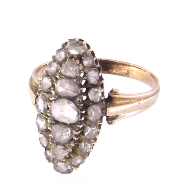 An antique 9k gold ring with rose cut diamonds