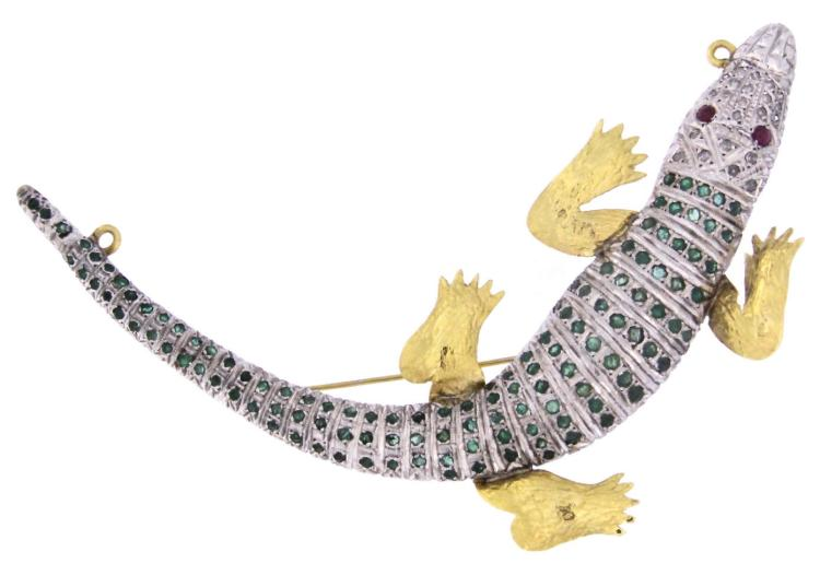An 18k two color gold crocodile pendent-brooch with rubies, emeralds and diamonds