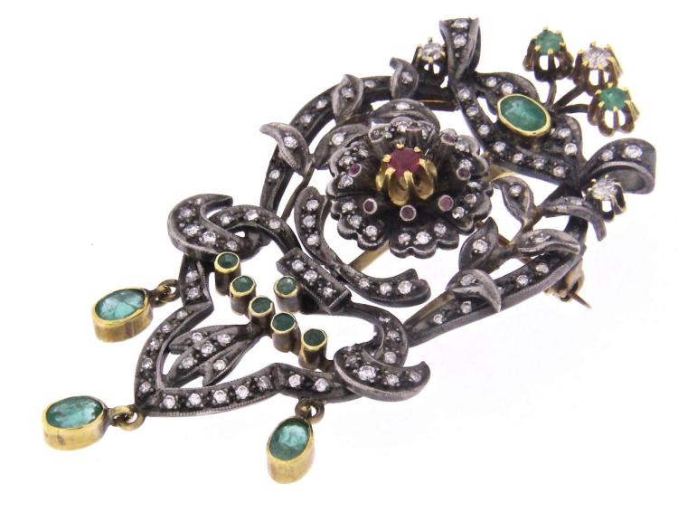 An antique 18k gold pendent-brooch with emeralds, rubies and diamonds