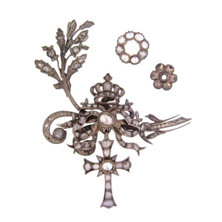 A rare antique 9k brooch with diamond.