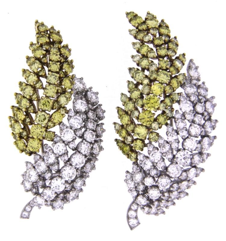Two amazing fancy yellow and white diamonds leaf brooches