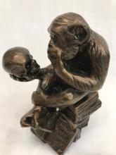 Bronze Sitting Monkey Statue Holding Skull