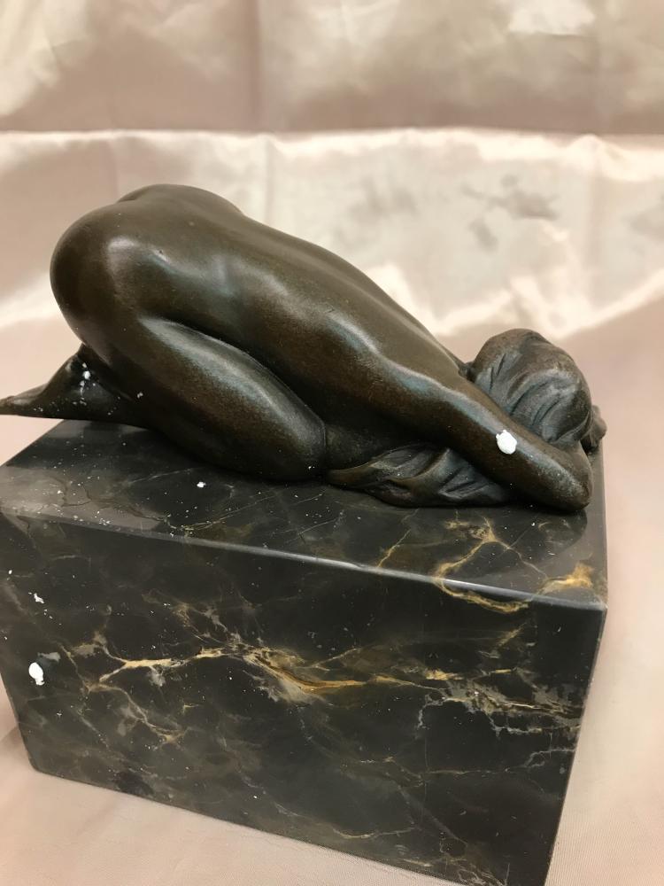 Lot - A 20th century bronze sculpture of a nude boy, 8 3/4