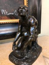 Bronze Man Kneeling Sharpening Knife from France