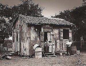 Theodore Fonville Winans (American/Louisiana, 1911-1992), Chighazola Shack, vintage silver gelatin photograph, signed and dated 1933 lower left, titled en verso, 16 in. x 20 in. E2000/3000 Note: In the early 1930s, the young photographer Fonville