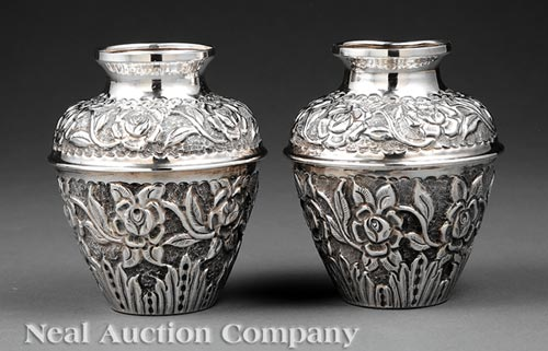 Pair of .800 Silver Repousse Urns