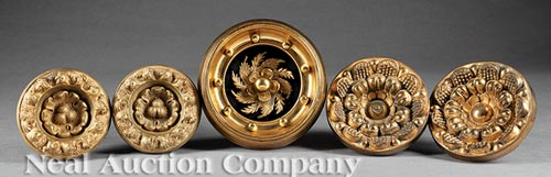 Five American Gilded and Pressed Brass Tie Backs