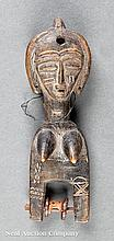 An African Carved Wood Weaving Pulley
