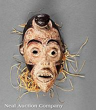 An African Polychrome Painted Carved Wood Mask