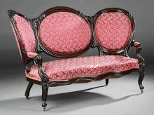 Pair of American Rococo Carved Rosewood Sofas