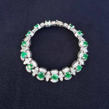 6.8ctw. Emerald and 9.8ctw. Diamond Tennis Bracelet