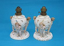 A pair of Sitzendorf porcelain oil lamps, in the