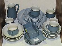 A collection of Denby pottery tableware, cups,