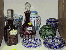A collection of coloured glass tableware,