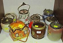 A collection of nine biscuit barrels, various