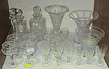A collection of cut glass drinking glasses,