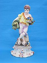 An Italian ceramic figure of a boy carrying