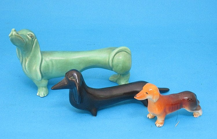 Three various ceramic models of Dachshund dogs,